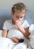 吹的女孩她小的鼻子 图库摄影