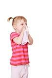 吹的女孩她的鼻子 免版税库存照片