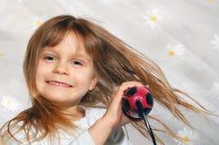 吹的干燥女孩头发她 图库摄影