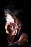 吹的烟 免版税库存图片