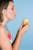 吹的蜡烛女孩 免版税库存图片