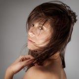 吹的头发和伟大的皮肤 图库摄影