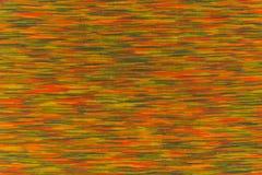 呈杂色的织品纹理用桔子和绿色接触 免版税库存图片