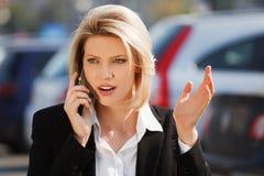 告诉的商业电话妇女 库存照片