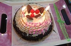 周年蛋糕切口 免版税库存照片