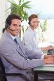 呼叫中心座席侧视图  免版税库存图片