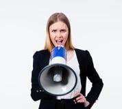 呼喊在扩音机的年轻女实业家 库存图片