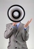 呼喊通过扩音机的商人 免版税库存照片