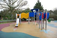 滑和在儿童游戏地面的其他设备 库存照片