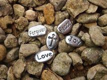 和平爱喜悦爱石头 免版税库存照片
