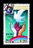 和平鸠、手、青年时期第13个世界节日和学生,平壤Iserie,大约1988年 库存照片