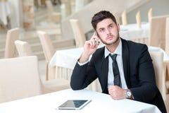 年轻和有动机的商人画象  免版税库存图片