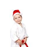 和服和佩带的圣诞老人帽子的逗人喜爱的小男孩 库存图片
