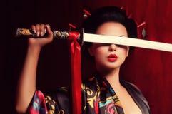 和服的美丽的艺妓 免版税库存图片
