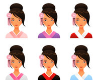 和服的逗人喜爱的日本女孩 免版税图库摄影