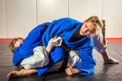 和服跆拳道妇女 库存照片
