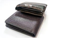 黑和棕色皮革钱包 免版税库存照片