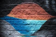 黑和银灰色橙色蓝色砖墙背景 免版税库存图片