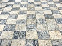 轻和黑暗的大理石正方形老地板  库存照片