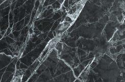 黑和黑暗的大理石纹理通过射击了与白色深刻成脉络 免版税图库摄影