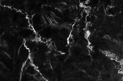黑和黑暗的大理石纹理通过射击了与白色深刻成脉络 图库摄影