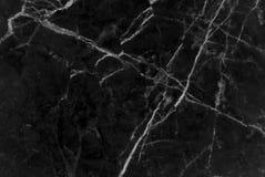 黑和黑暗的大理石纹理通过射击了与白色深刻成脉络 库存图片