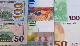 100和50欧元美元,瑞士法郎背景 免版税库存照片