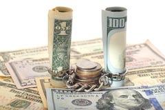 $ 100和$ 1硬币和链子 库存照片