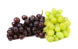 黑和绿色成熟葡萄。 库存图片