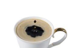 咖啡与咖啡下落的  免版税图库摄影