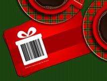 咖啡与圣诞节销售优惠券的在桌布 库存照片