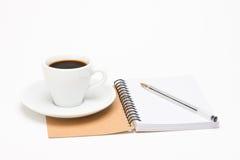 咖啡与笔记本的 库存照片