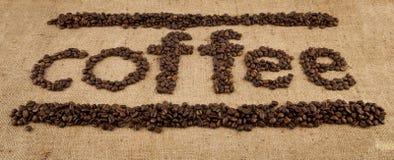 从咖啡五谷的题字  免版税库存照片