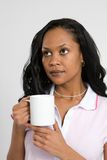 咖啡体贴的妇女 免版税库存图片
