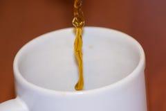 咖啡倾吐 库存图片