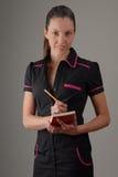 咖啡减速火箭的统一女服务员 免版税库存图片