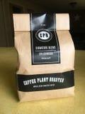 咖啡厂烘烤器署名浓咖啡混合 免版税库存照片