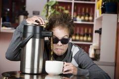 咖啡发狂的人年轻人 免版税图库摄影