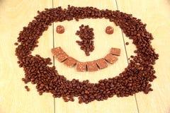 咖啡和巧克力面带笑容  免版税库存图片