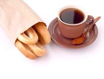 咖啡和百吉卷 库存照片
