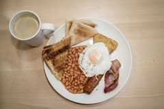 咖啡和等待的早餐 图库摄影