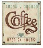 咖啡在压印的锡的标志葡萄酒打开24个小时 图库摄影