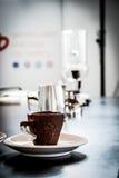 咖啡在另外浓咖啡的乌克兰哺养 免版税库存照片