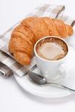 咖啡新月形面包 库存照片