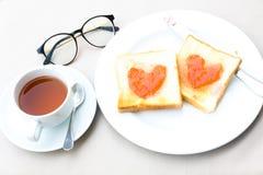 咖啡早餐设置用面包 免版税库存图片
