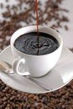 咖啡杯倾吐 免版税库存照片