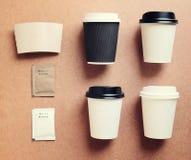 咖啡杯嘲笑为烙记从顶视图的身分 库存照片