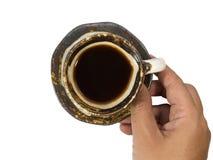 咖啡杯在手边 免版税库存照片