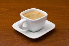 咖啡杯浓咖啡表 免版税库存图片