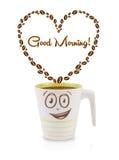 咖啡杯用咖啡豆塑造了与早晨好标志的心脏 免版税库存图片